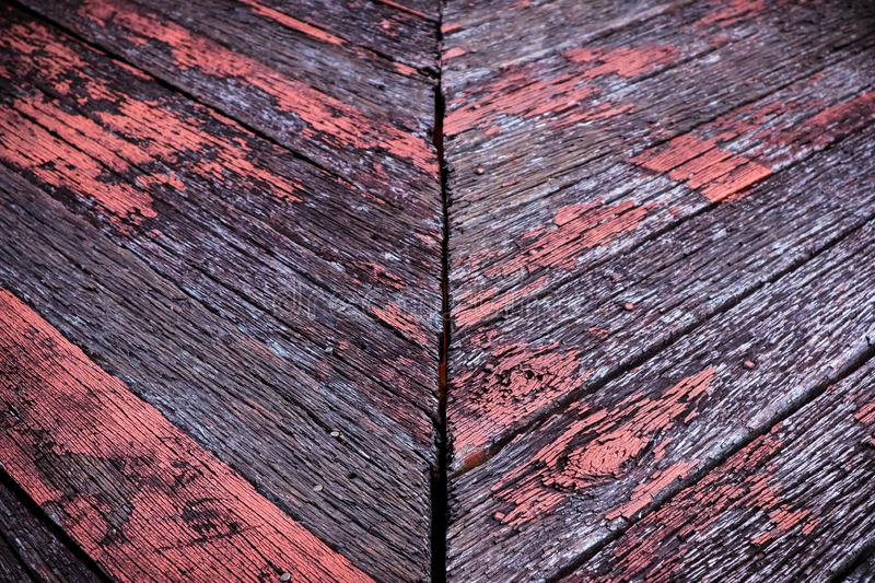 Old orange grey wood diagonally align with crack background. It is due exposure to the weather stock photography