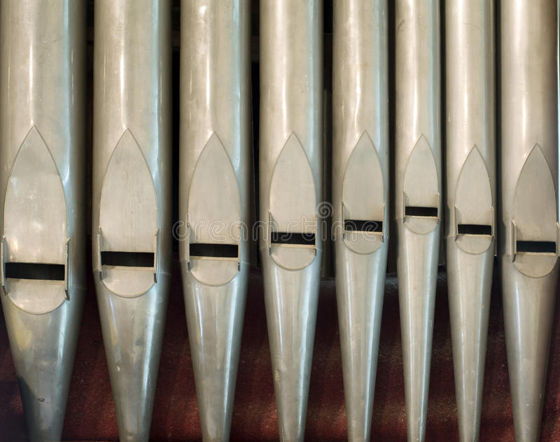 Old organ pipes. A row of organ pipes on an old church organ stock photo