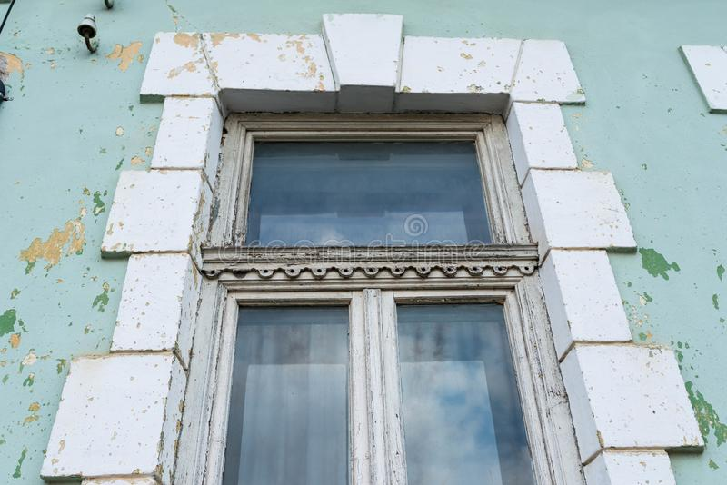 Old, ornamented window close up shot. On european abandoned residentual house stock photos