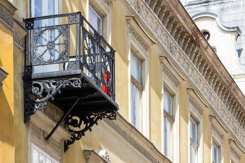 Old ornamented wrought iron balcony. Old black ornamented wrought iron balcony in Gyor, Hungary stock photo