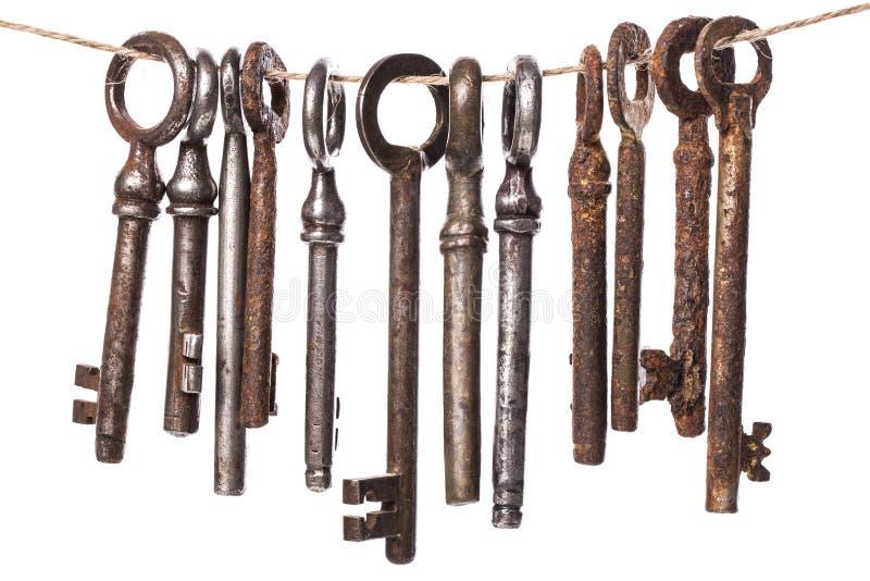 Old, ornate keys. Vintage. Old, rustic keys on a white background royalty free stock images