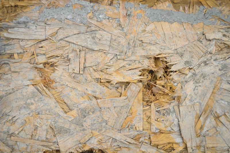 Old OSB plate consisting of pressed pine tree chips. Background can be royalty free stock photography