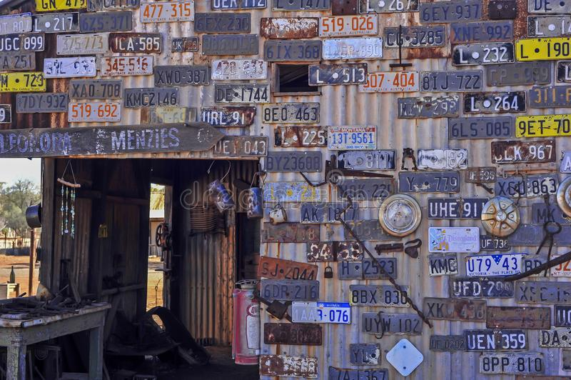 Old and out of circulation car number plates, now defunct and collectors pieces, mounted on a wall stock photo