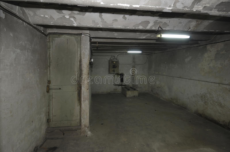 Old outdated room in the basement of a house with stock photo
