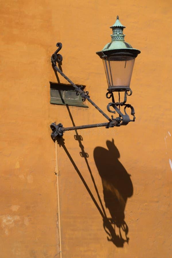 Old outdoor wall mounted lamp, Copenhagen, Denmark stock photo