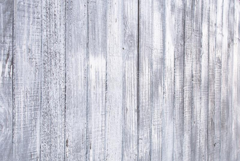 Old outdoor wooden fence painted of white paint for texture background royalty free stock photography