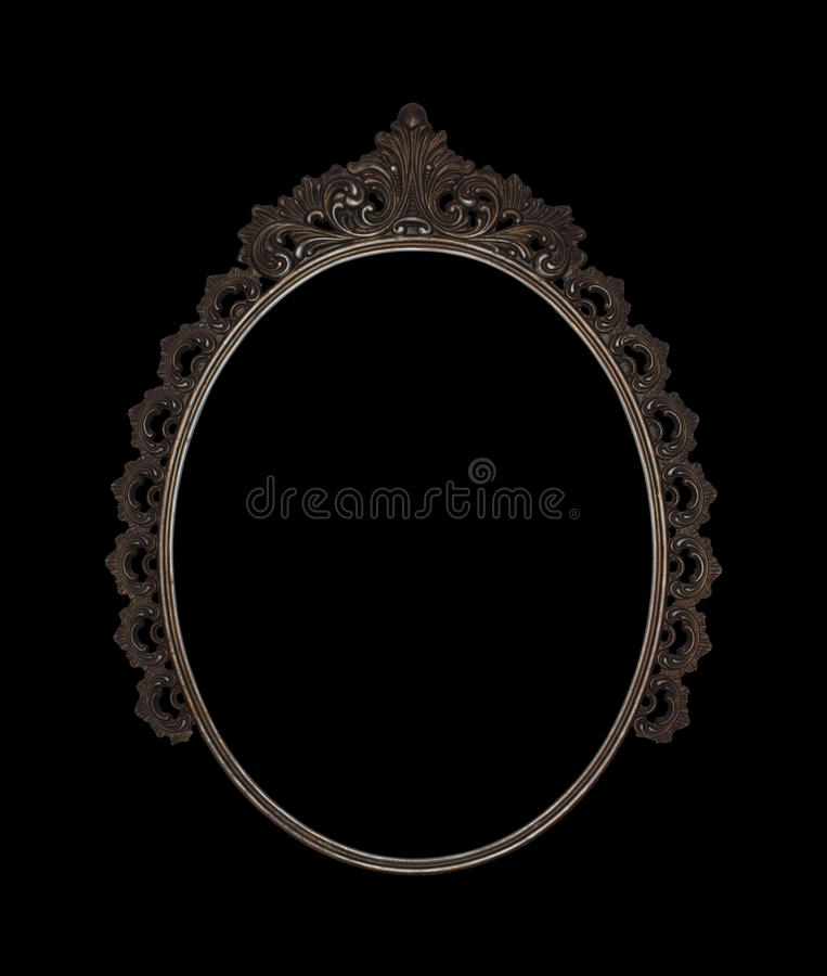 Old oval picture frame metal worked on black background. Old oval picture frame metal worked isolated on black background stock photo