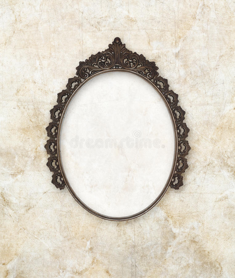 Old oval picture frame metal worked on marble background stock images