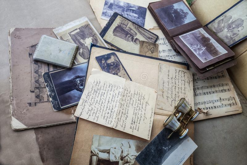 Old photos,books and newspapers background.on dark stock photography