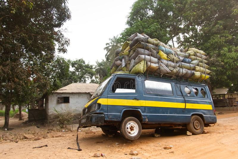 Old and overloaded transport with goods on its roof and inside stock photos