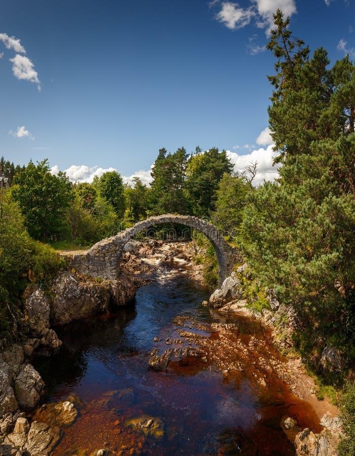 Old Pack Horse Bridge in Dulnain Bridge, Carrbridge, Scotland. UK royalty free stock image