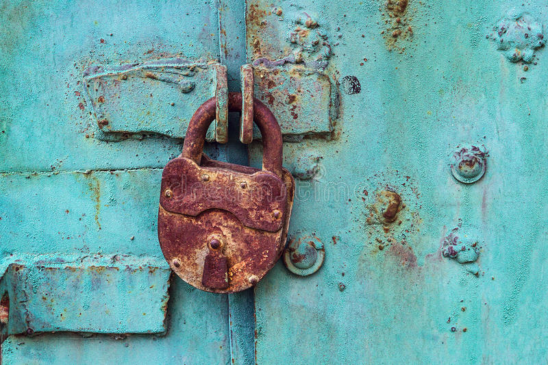 Old padlock on a blue door stock photos