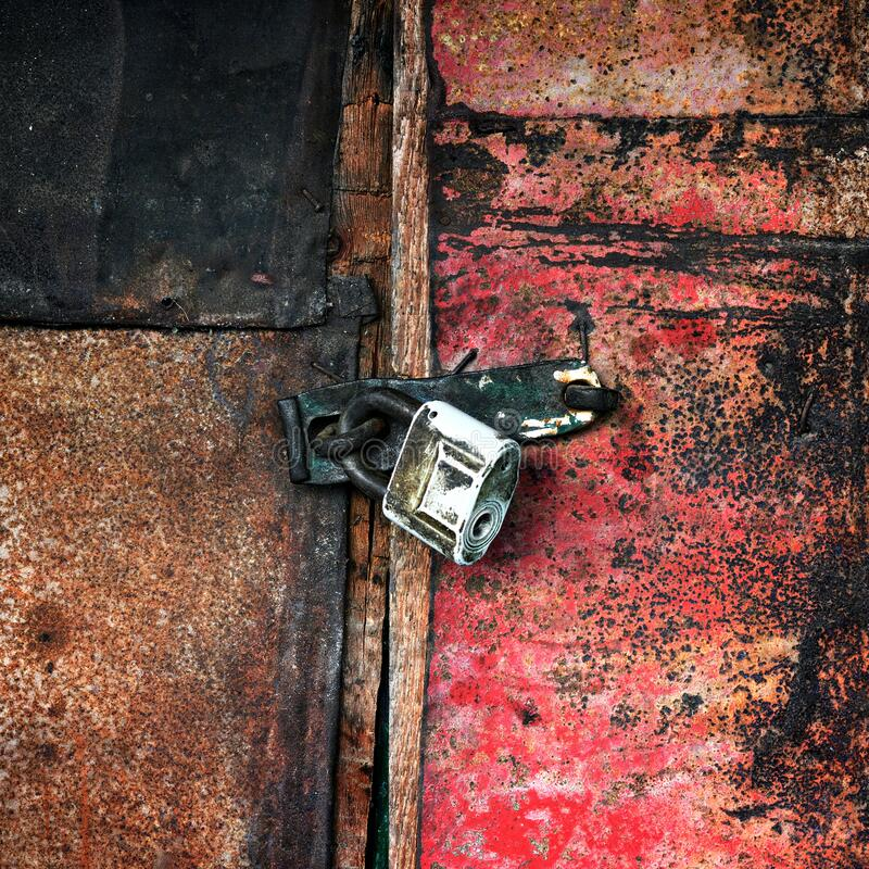 Old padlock on the door of the barn royalty free stock images