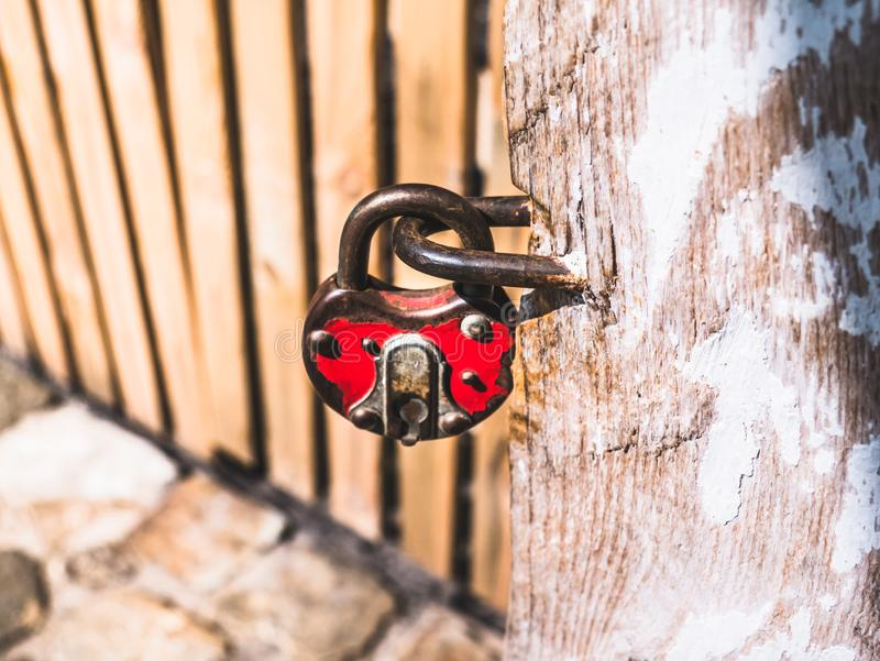 Old padlock hanging by the door royalty free stock image