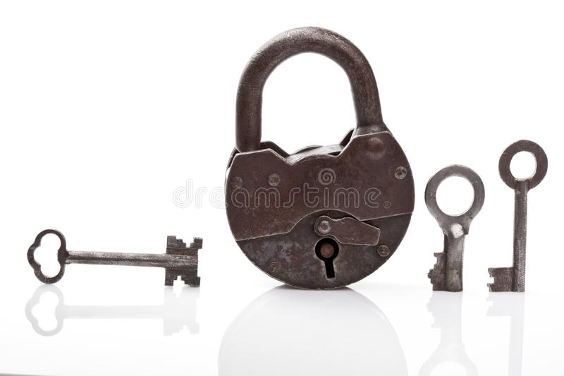 Old padlock and keys. On white stock image