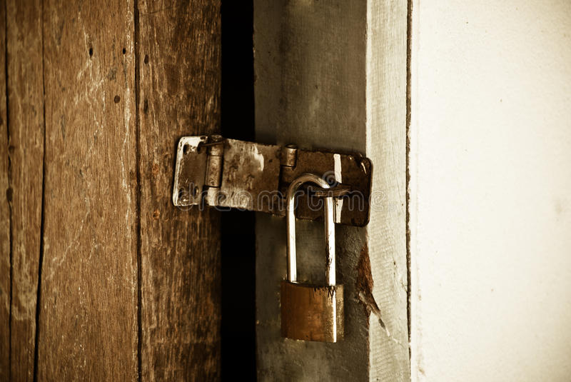 Download Old Padlock On A Wooden Door Royalty Free Stock Photography - Image: 33998627