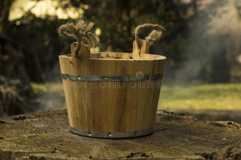 Old pail. Old ancient pail on the stump royalty free stock photos