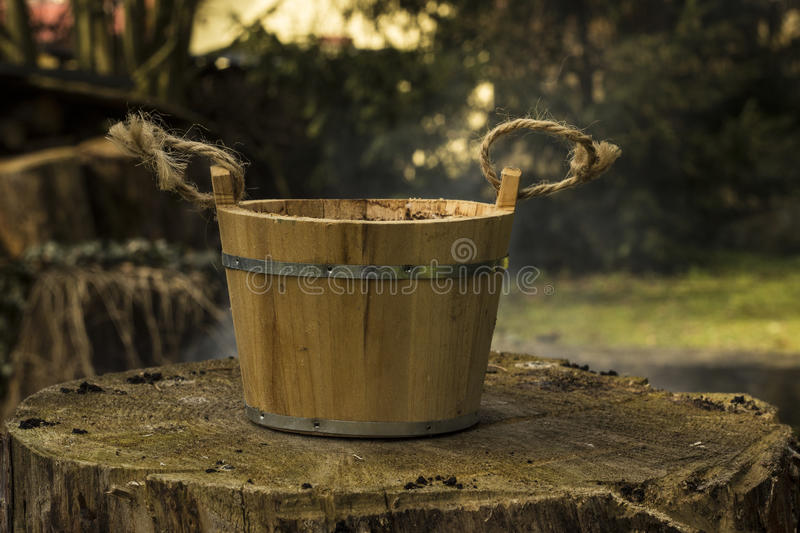 Old pail. Old wood bucket on the stump stock images