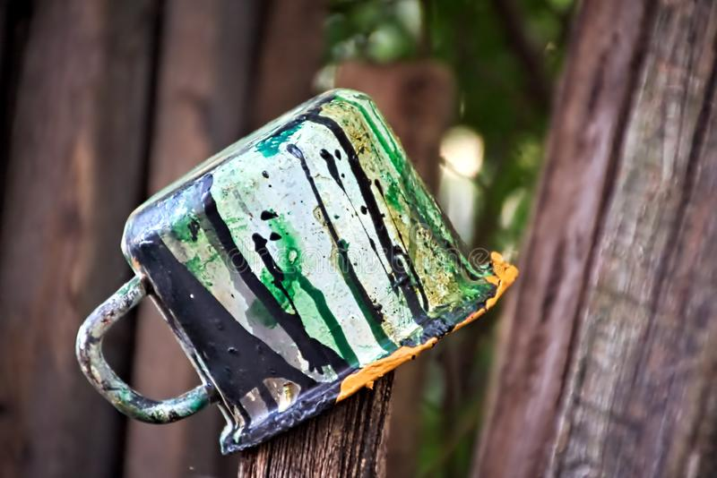 Old paint mug on the fence royalty free stock images