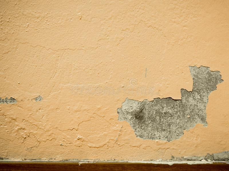 Old Paint peeling plaster walls damage surface. A background of peeling paint, the old paint texture is chipping and cracked fall stock images