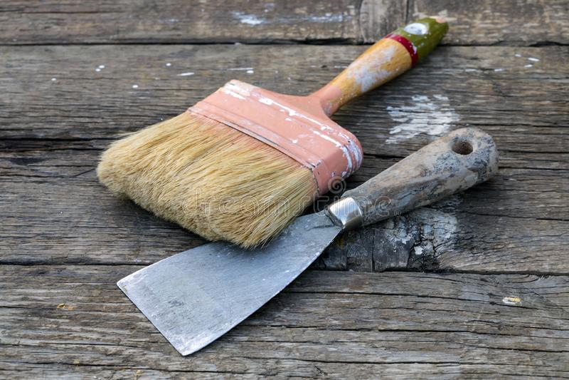 Old Paintbrush and Spatula stock photos