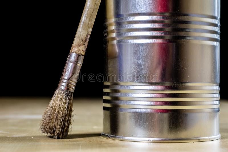 Old paintbrushes for paint, Cans of paint on wooden table. Paint stock photos