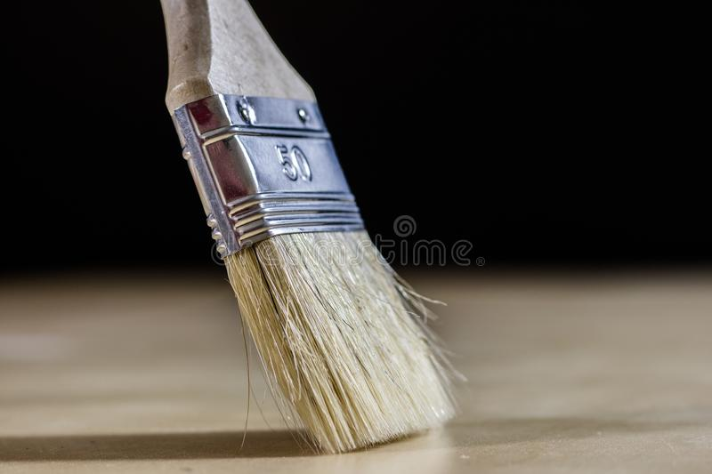 Old paintbrushes for paint, Cans of paint on wooden table. Paint stock images