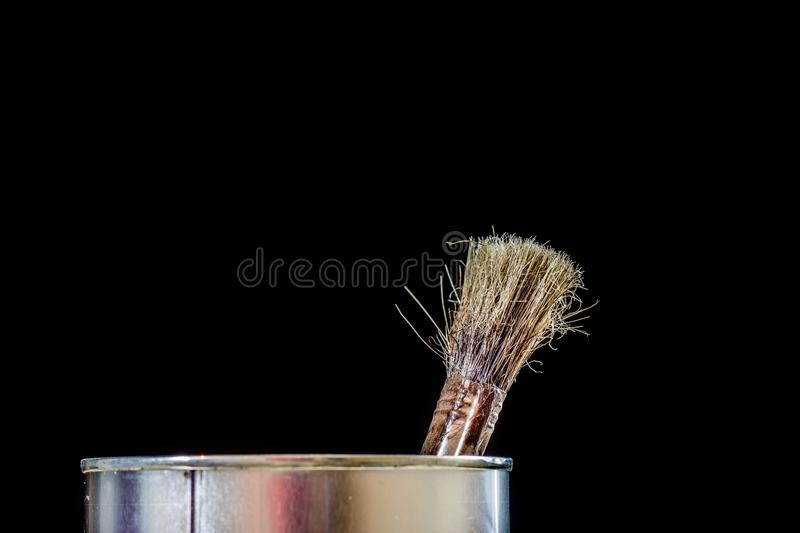 Old paintbrushes for paint, Cans of paint on wooden table. Paint stock photo