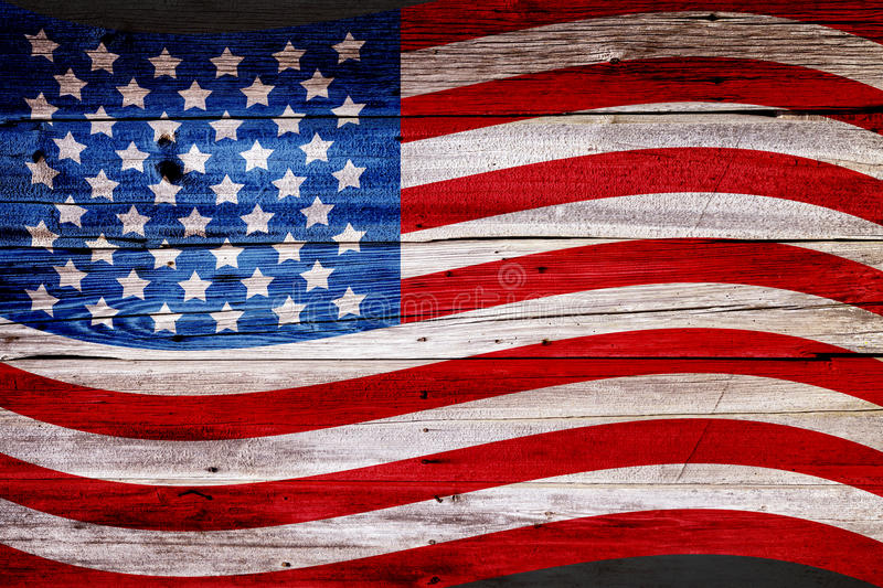 Old Painted American Flag. On Dark Wooden Fence royalty free stock image