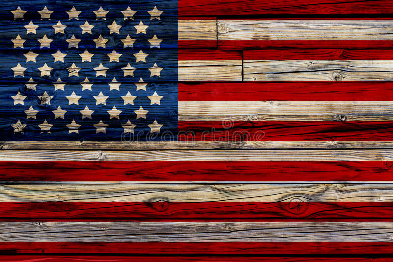 Old Painted American Flag. On Dark Wooden Fence royalty free stock photography