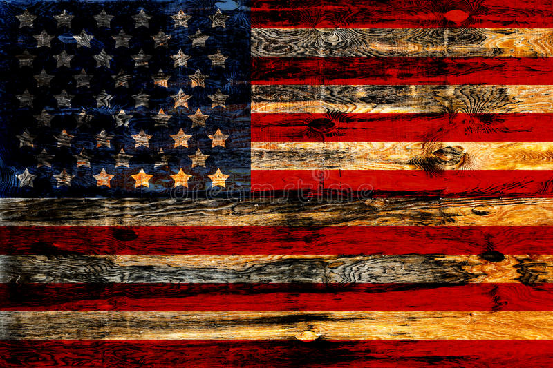 Old Painted American Flag. On Dark Wooden Fence stock photos