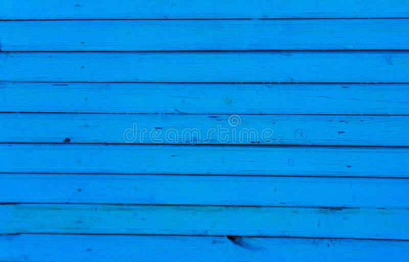 Old painted blue wall paint, the old wooden background. Background of horizontal slats painted in blue color stock images
