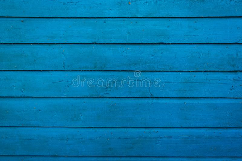 Old painted  blue wooden wall. Wood plank texture background royalty free stock image