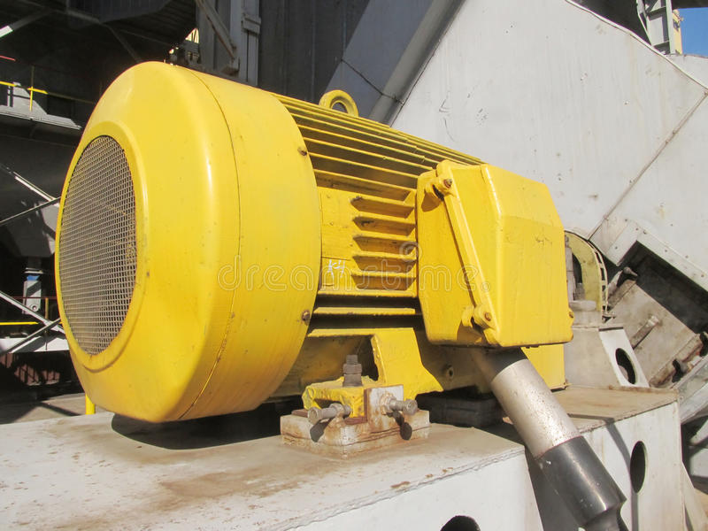 Old, painted electric motor. As drive exhaust fan stock image