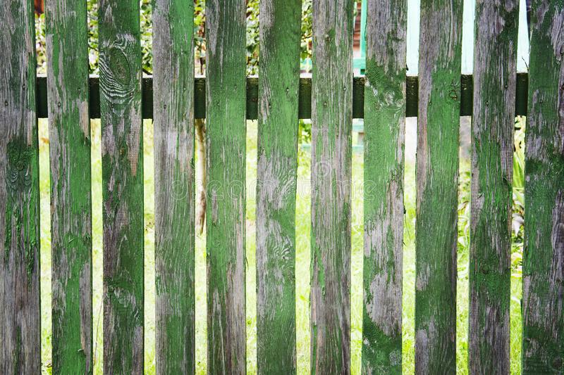 Old painted green wooden fence, peeling paint.  royalty free stock photo