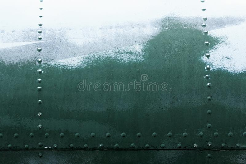 Old painted metal background detail of a military aircraft, surface corrosion. Old painted metal background detail of a military aircraft, surface corrosion royalty free stock photos