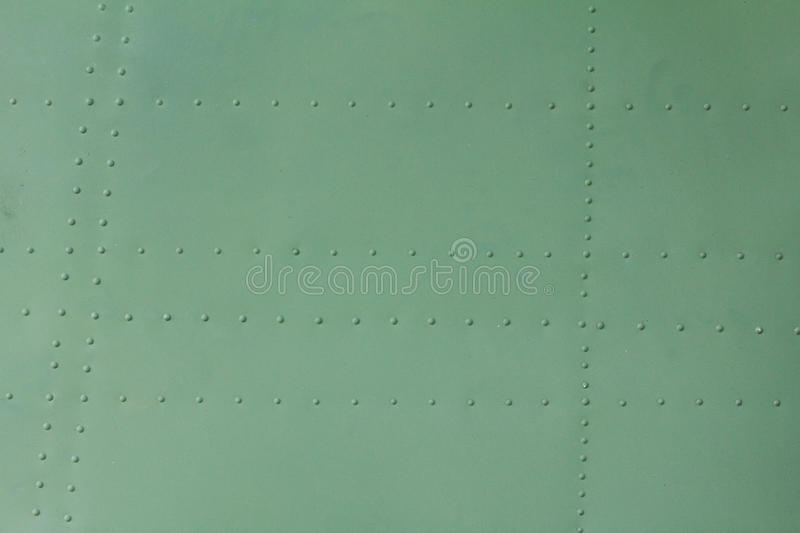 Old painted metal background detail of a military aircraft, surface corrosion. Old painted metal background detail of a military aircraft, surface corrosion stock photography