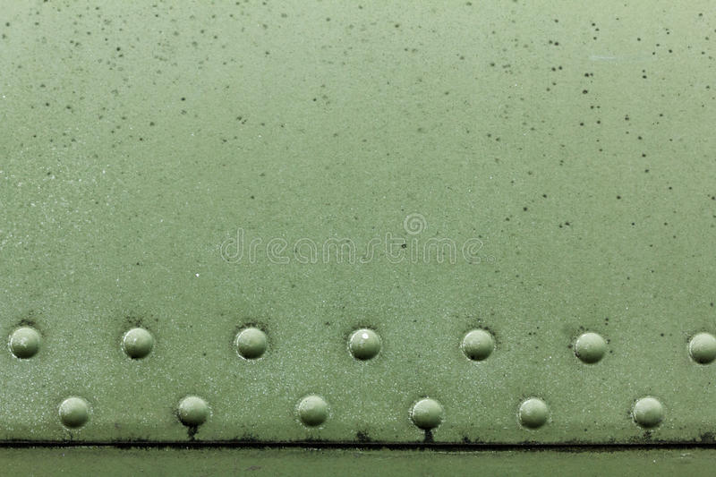 Old painted metal background detail of a military aircraft, surface corrosion. Old painted metal background detail of a military aircraft, surface corrosion royalty free stock images