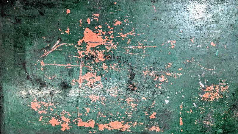 Old painted metal table in green and orange worn time royalty free illustration