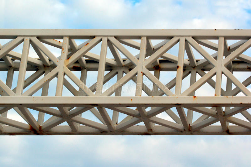 Old painted metal truss. On cloudy sky background royalty free stock photos