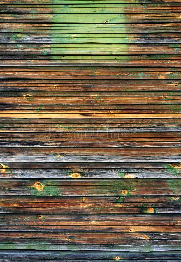 Old painted peeled off dark brown wood planks texture background backdrop royalty free stock image