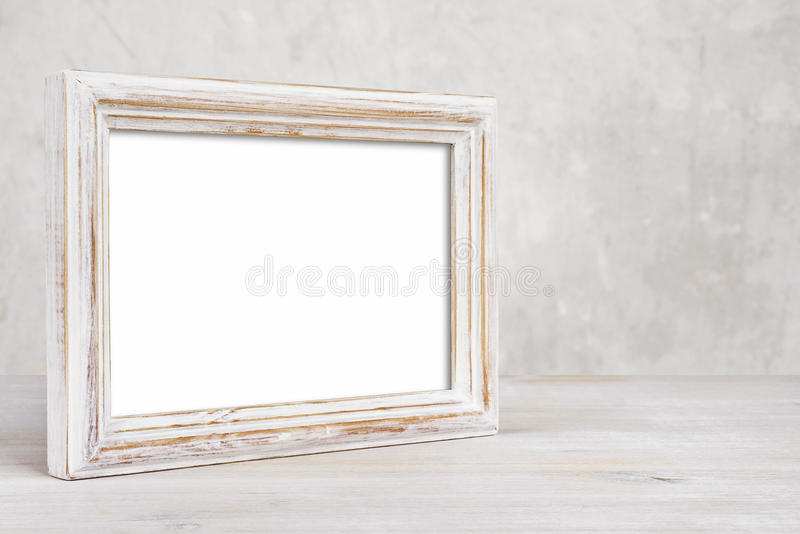 Old painted photo frame on table over abstract background royalty free stock photo
