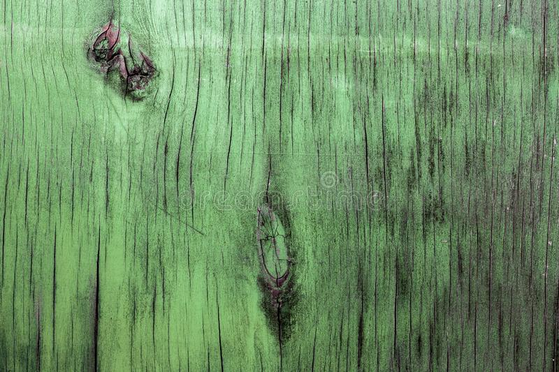 Old painted plywood sheet closeup surface texture.  stock images