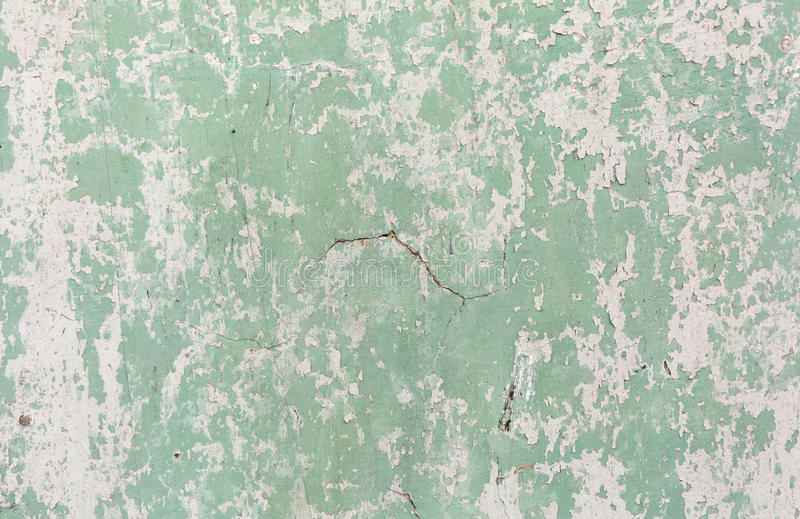 Old painted wall. Green and damage surface. Peeling paint background. Stone demaged backdrop. stock image