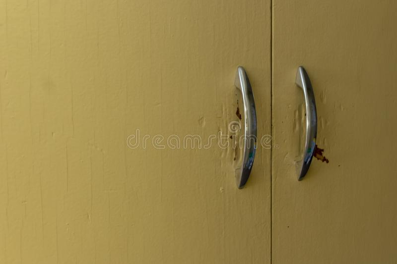 Old painted wood cabinet doors with chrome handles. Old painted wood cabinet doors with chipped pain and chrome handles royalty free stock photography