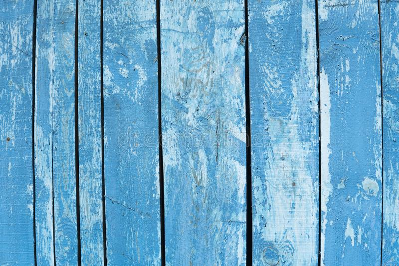 Old painted wood wall. Texture. Vintage wood background with peeling paint. Painted Plain Teal Blue and white Rustic stock image