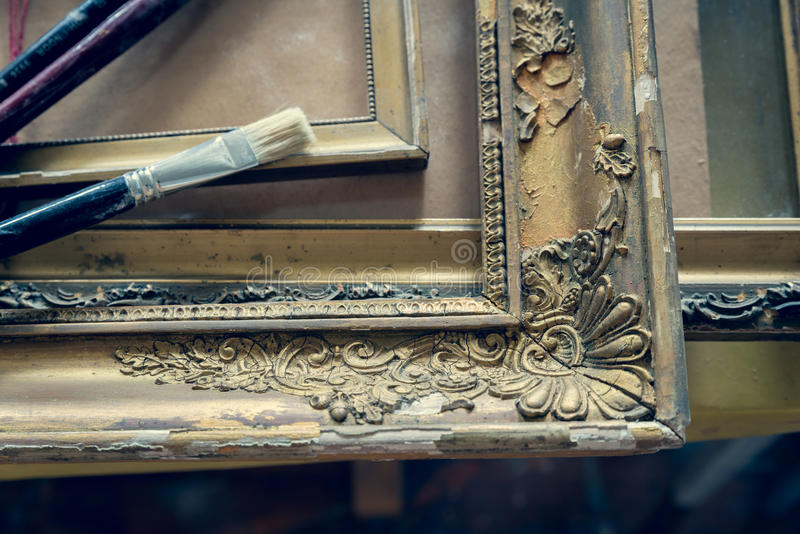 Old paintings frames. Old wooden painting frames in painter studio royalty free stock photography