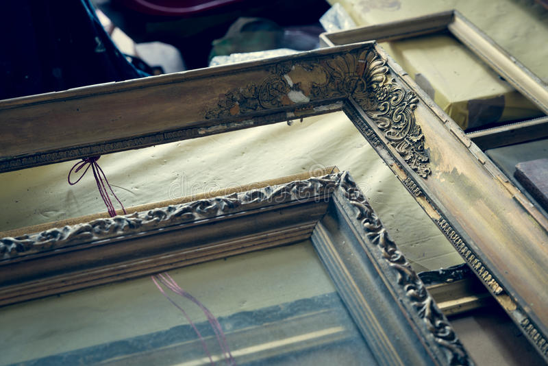 Old paintings frames. Old wooden painting frames in painter studio stock images