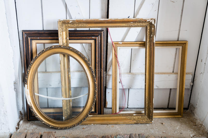 Old paintings frames. Old wooden painting frames in painter studio royalty free stock images