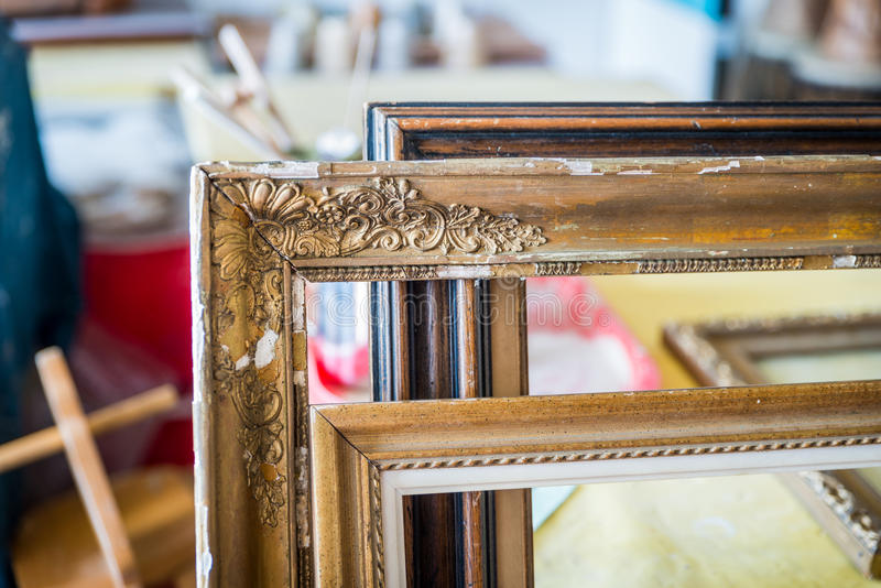 Old paintings frames. Old wooden painting frames in painter studio royalty free stock photo